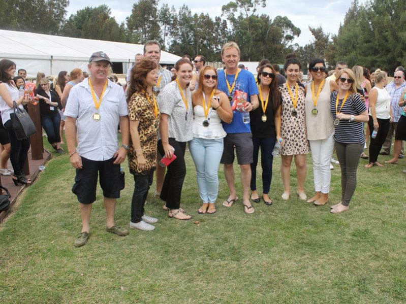 Delegates wearing yellow medals because they are the winners of the team building activity Flat Out On The Buses.