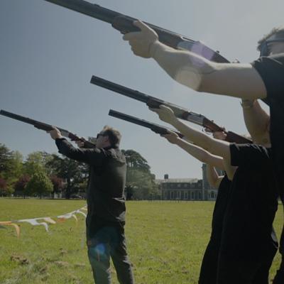 Team preparing to shoot their guns during Laser Clay Pigeon Shooting with Orangeworks