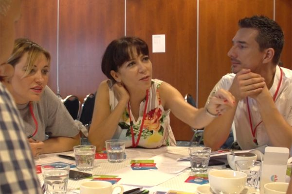 Delegates discussing ideas during the team bonding exercise Global Innovation Game by Orangeworks.