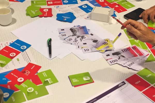 Global Innovation Game cards and money