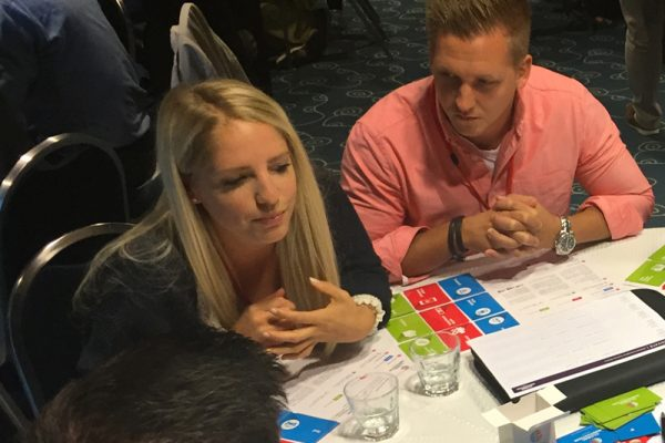Delegates discussing ideas during Global Innovation Game