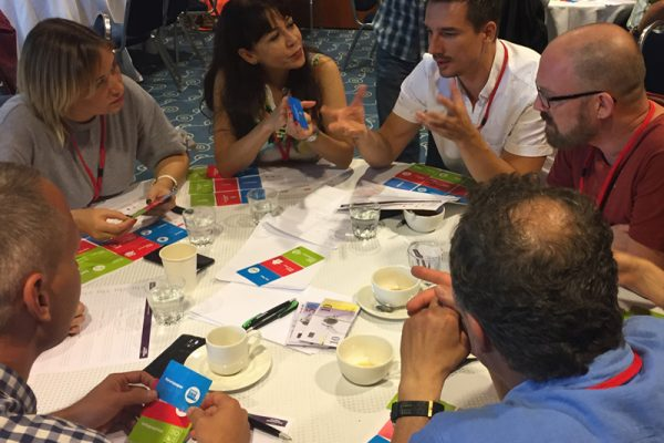 Team discussing ideas during Global Innovation Game