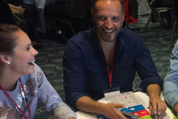 Delegates laughing during Global Innovation Game, a team-building exercise that inspires entrepreneurship and creativity.