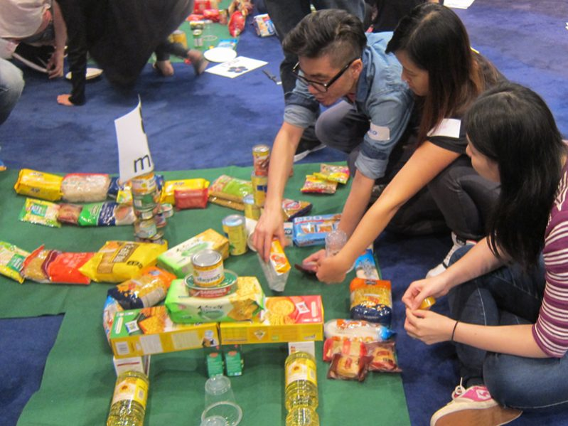 Delegates building their mini-golf course out of canned & non-perishable food, as part of their charity themed corporate day.