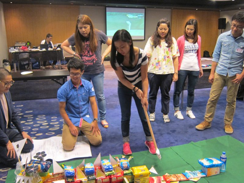 Delegates during their Hole in One golf game, a charity based team bonding activity by Orangeworks.