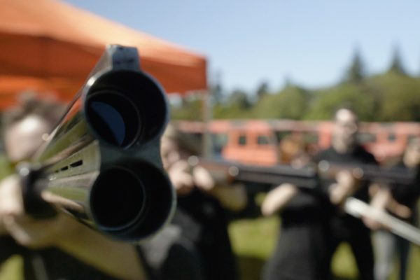 Close up of the barrel of a gun during Laser Clay Pigeon Shooting, outdoor team building activity.