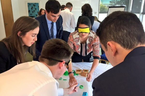 Blindfolded delegates putting their Need 4 Speed cars together
