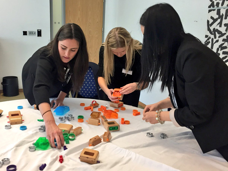 Delegates putting their Need 4 Speed cars together during the charity based team building challenge with Orangeworks.