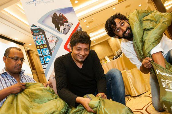 Delegates taking out their sleeping bags in Peak Performance