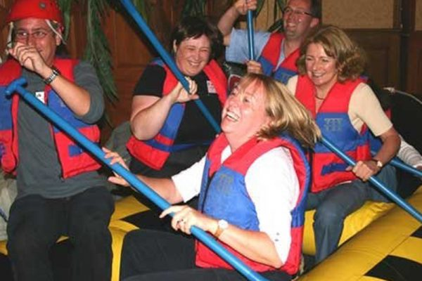 Delegates laughing during River Runner team building experience