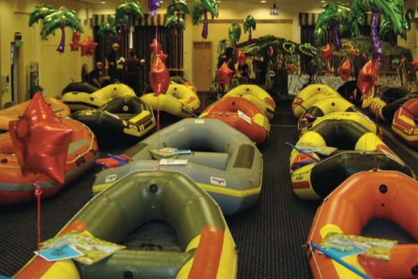 Inflatable boats set up for River Runner team building activity