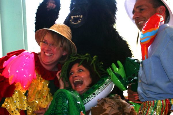 Delegates smiling in their River Runner costumes