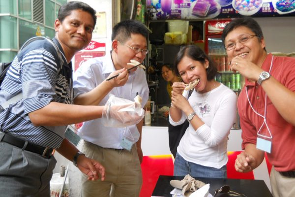 Team trying local food whilst filming their Travel Show