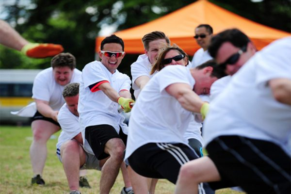 Delegates in the middle of Tug of War challenge during their Corporate Sports Day team building with Orangeworks.