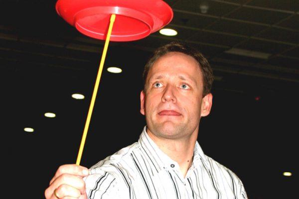 Delegate focusing on balancing a plate during Urban Circus