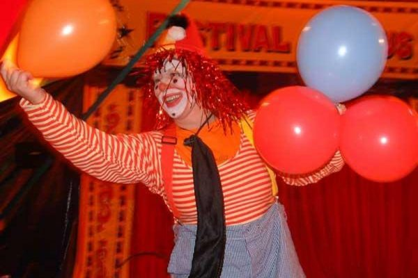 Laughing clown with balloons during Urban Circus