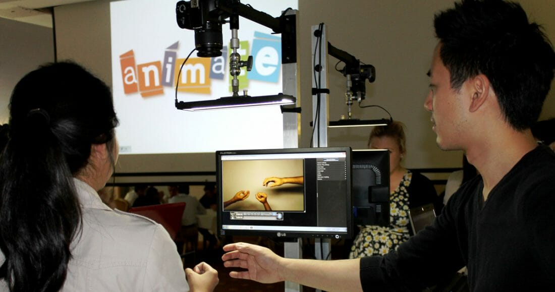 Two delegates filming their stop motion animation during Animate, the innovative team building activity with Orangeworks
