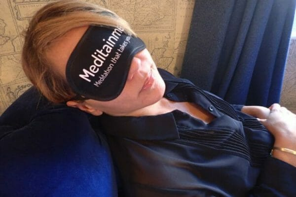 Woman wearing eye mask during Meditainment event with Orangeworks