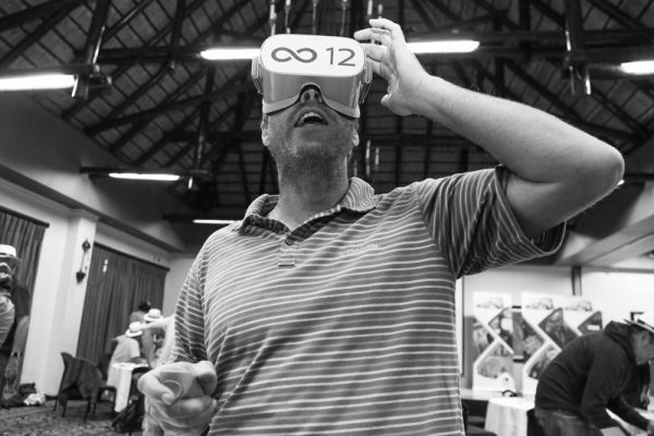 Delegate wearing VR headset during The Infinite Loop team building game.