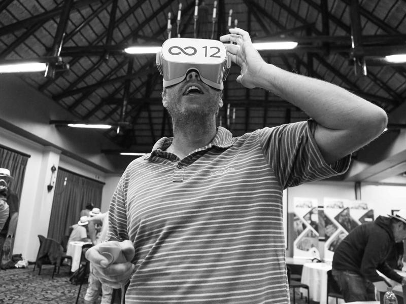Delegate wearing VR headset during The Infinite Loop team building game.