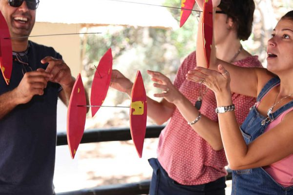 Delegates fixing and assembling their art sculpture made of recyclable materials during the charitable team activity.