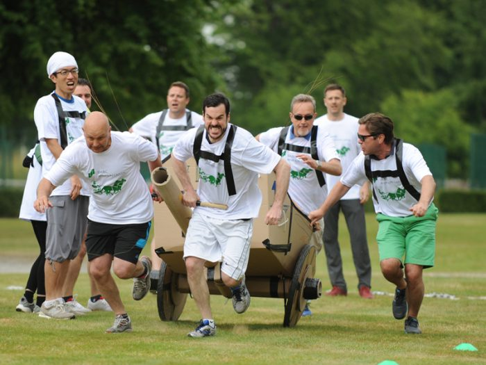 Delegates running with their chariot during the final race of Flat Out Chariot, a team bonding activity by Orangeworks
