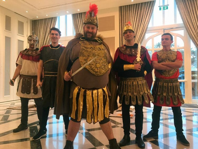 The Orangeworks team dressed as romans for the team building Flat Out Chariot Challenge