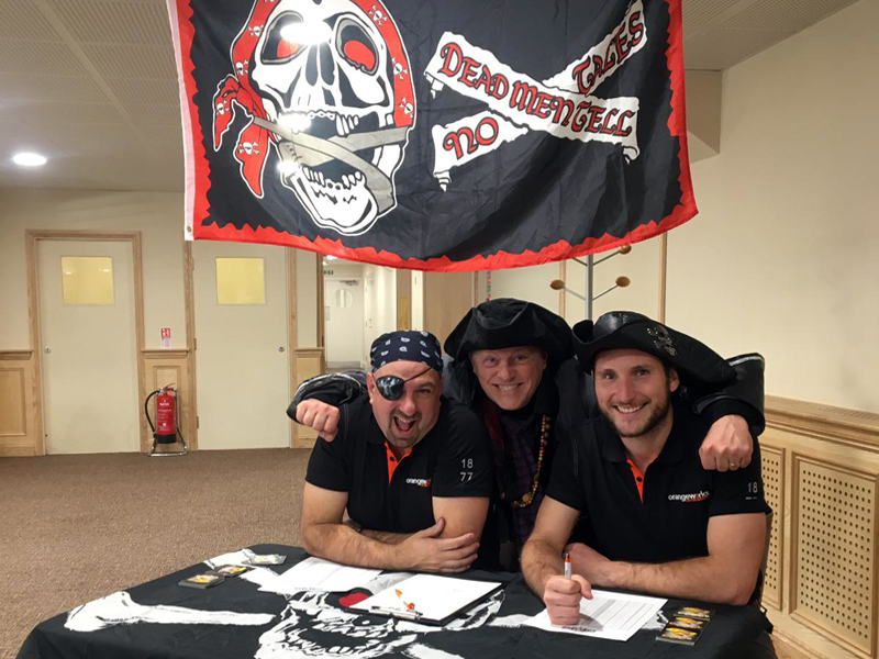 The Orangeworks team ready for the pirate-themed team building game called Trade Winds.