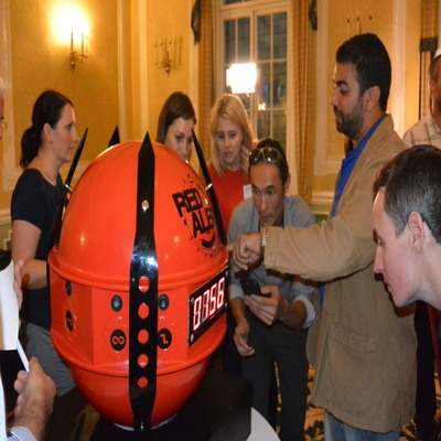 Delegates gathered around the Red Alert Sphere as they crack the codes for this fun team building exercise.
