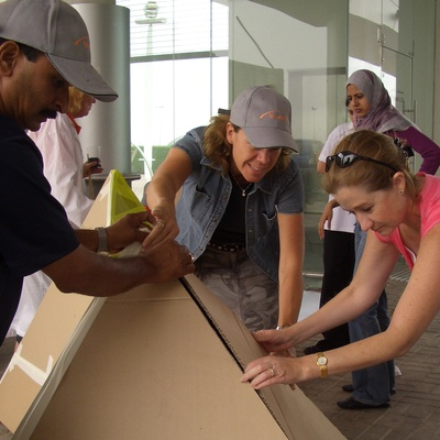 A team of participants building their cardboard pyramid together during the team building challenge organised by Orangeworks.