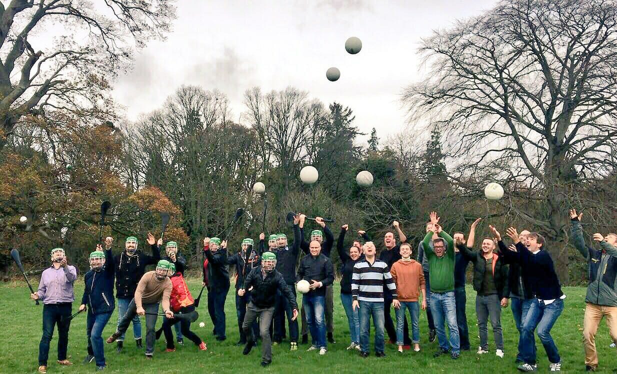 Delegates playing hurling and gaelic footbal together during their corporate sports day with Orangeworks.