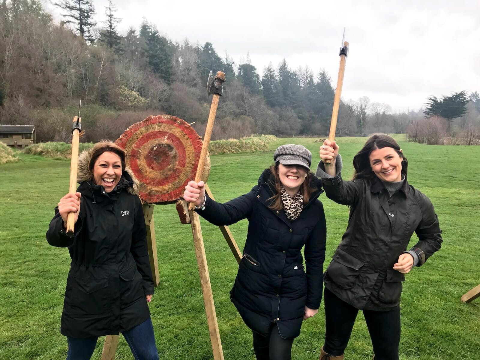 Delegates holding up their axes during Axe Throwing with Orangeworks.