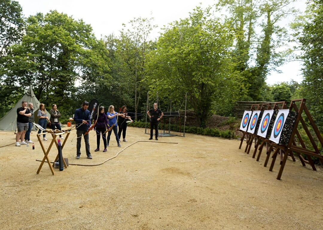 Delegates learning how to become archers during Orangeworks outdoor team building activities at Druids Glen.