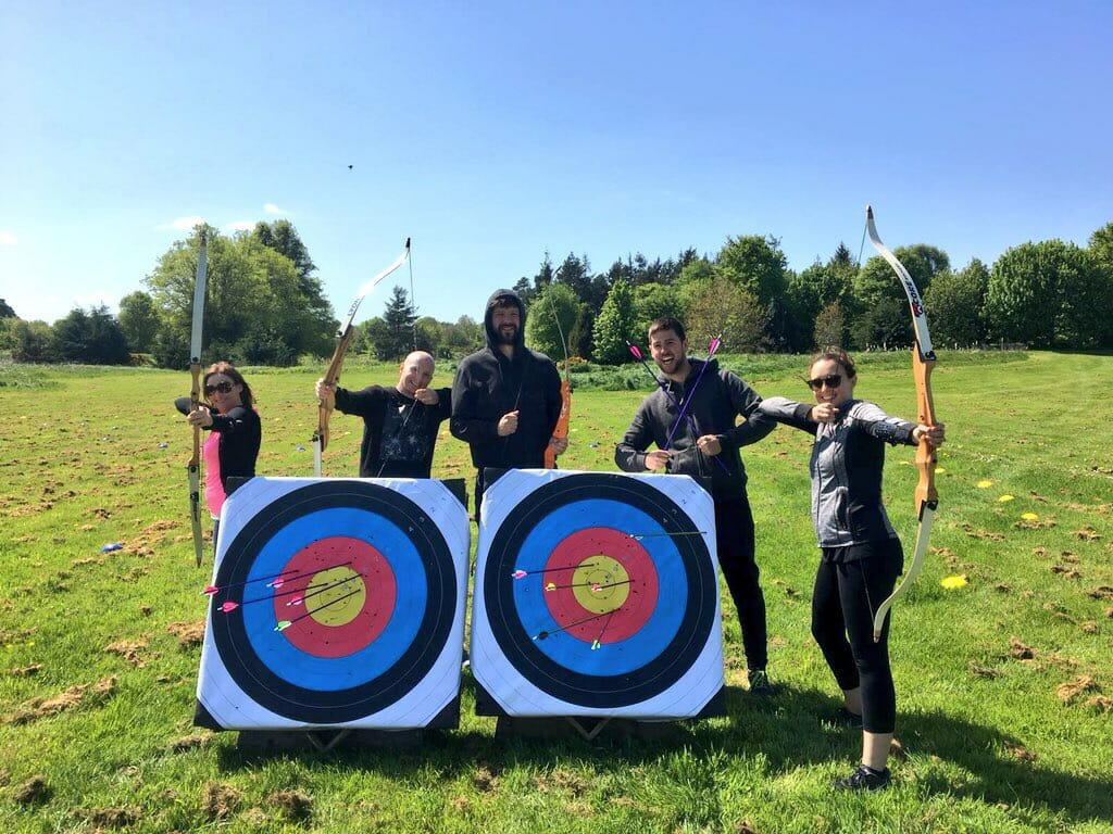 Delegates of Orangeworks outdoor team building activity playing archery.