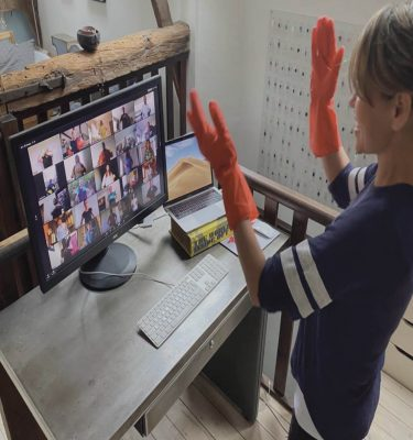 Delegate playing Orangeworks virtual team building game called Body Rap, on Zoom with her remote working team.