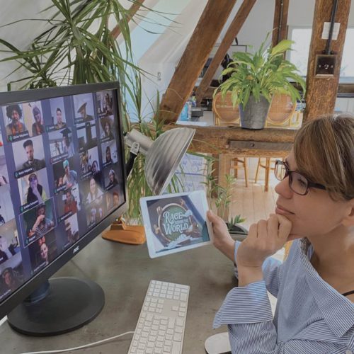 Mary engaging in one of Orangeworks remote team building activities with her colleagues on their Zoom video meeting.