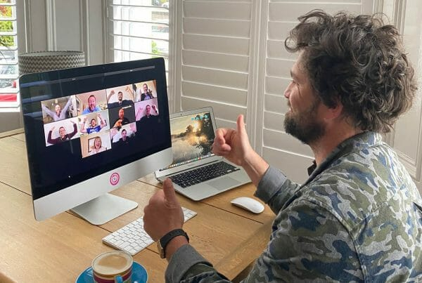 Delegate debriefing with his team after an Orangeworks remote team building activity on Zoom.