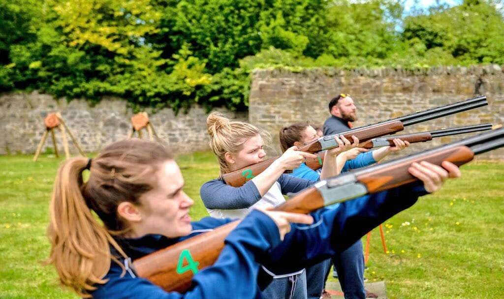 Delegates conducting a laser clay shooting activity with Orangeworks at their Adventure Zone at Carton House.