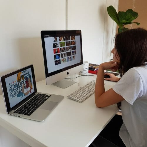 Delegate playing one of Orangeworks virtual team building activities with her remote team.