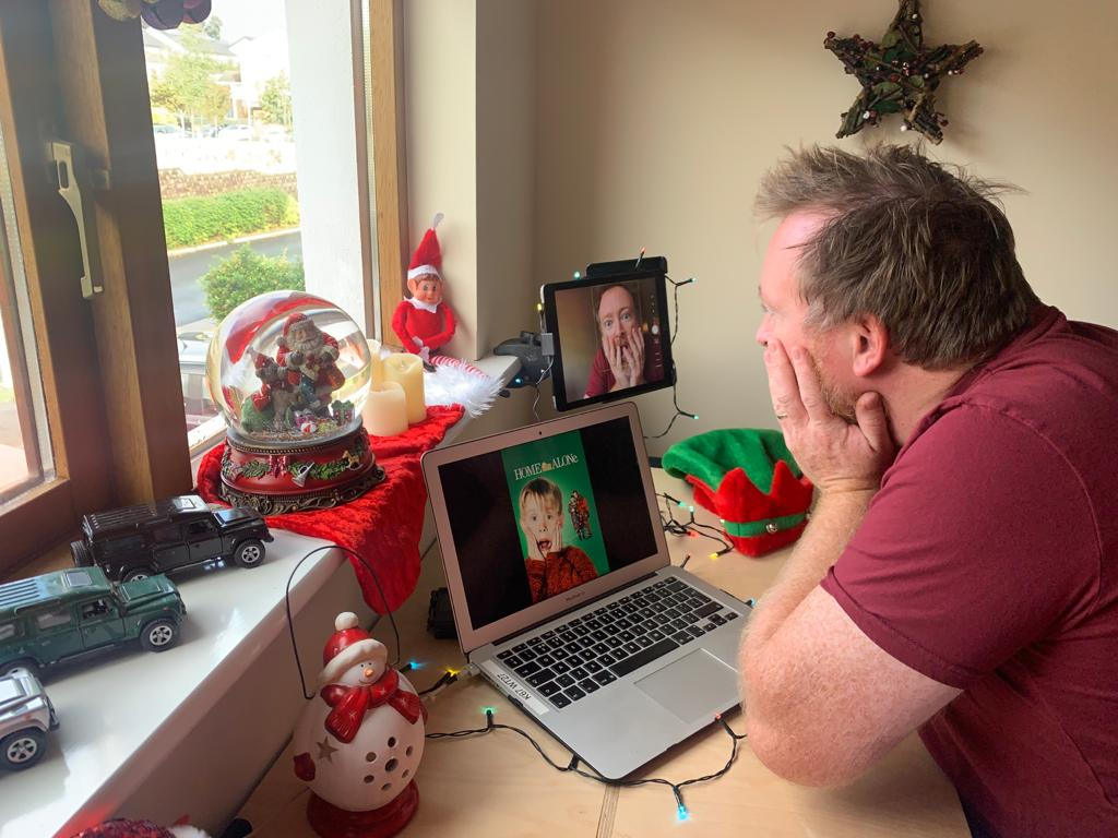 Delegate recreating a photo from Home Alone during one of Orangeworks virtual Christmas team building activities.
