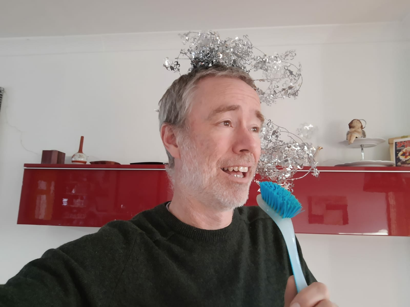 Delegate pretending to sing during one of Orangeworks Christmas team building activities, Christmas Lip Sync Sing A Long.