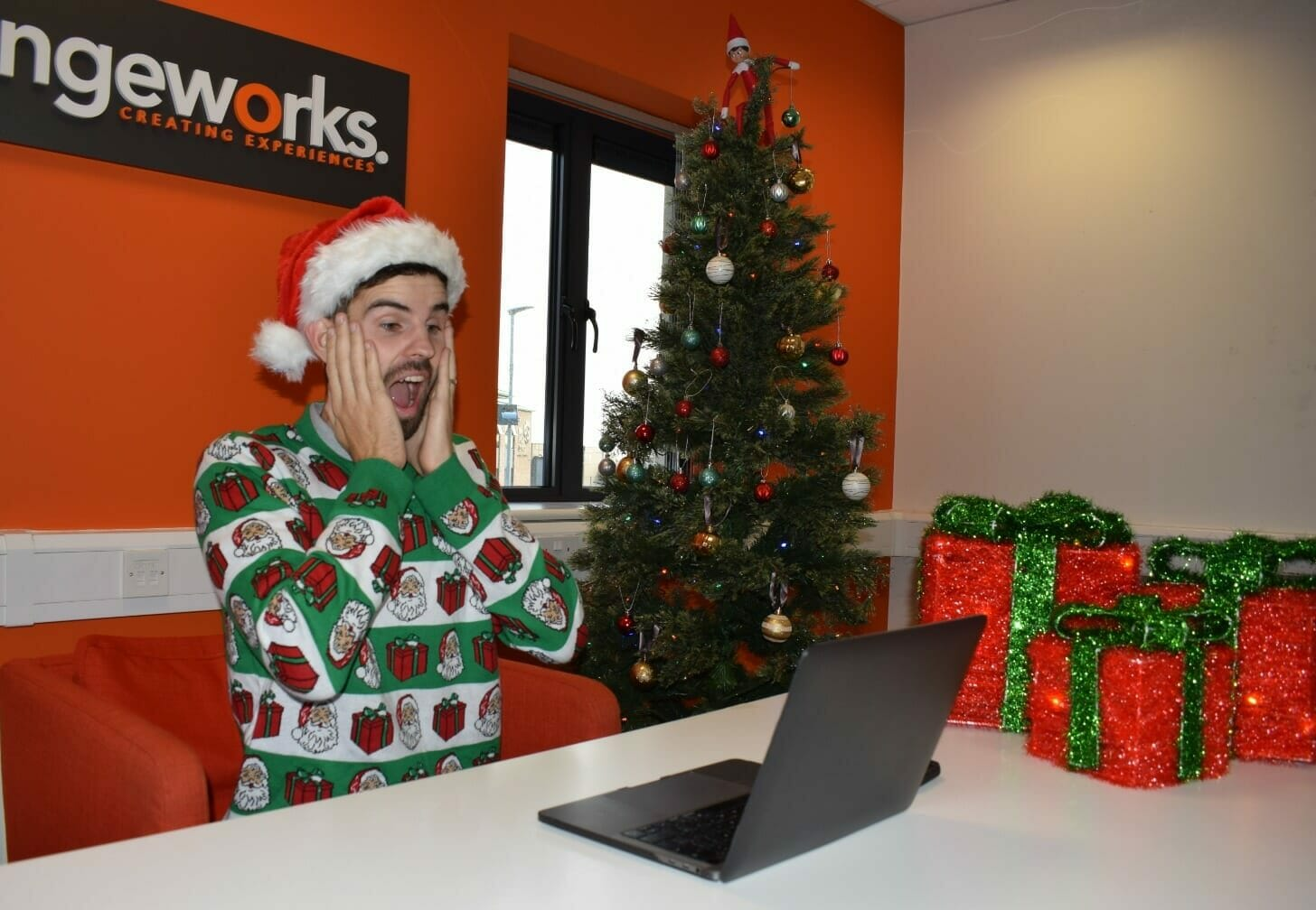 Delegate looking shocked at his laptop during one of Orangeworks virtual company Christmas party games.
