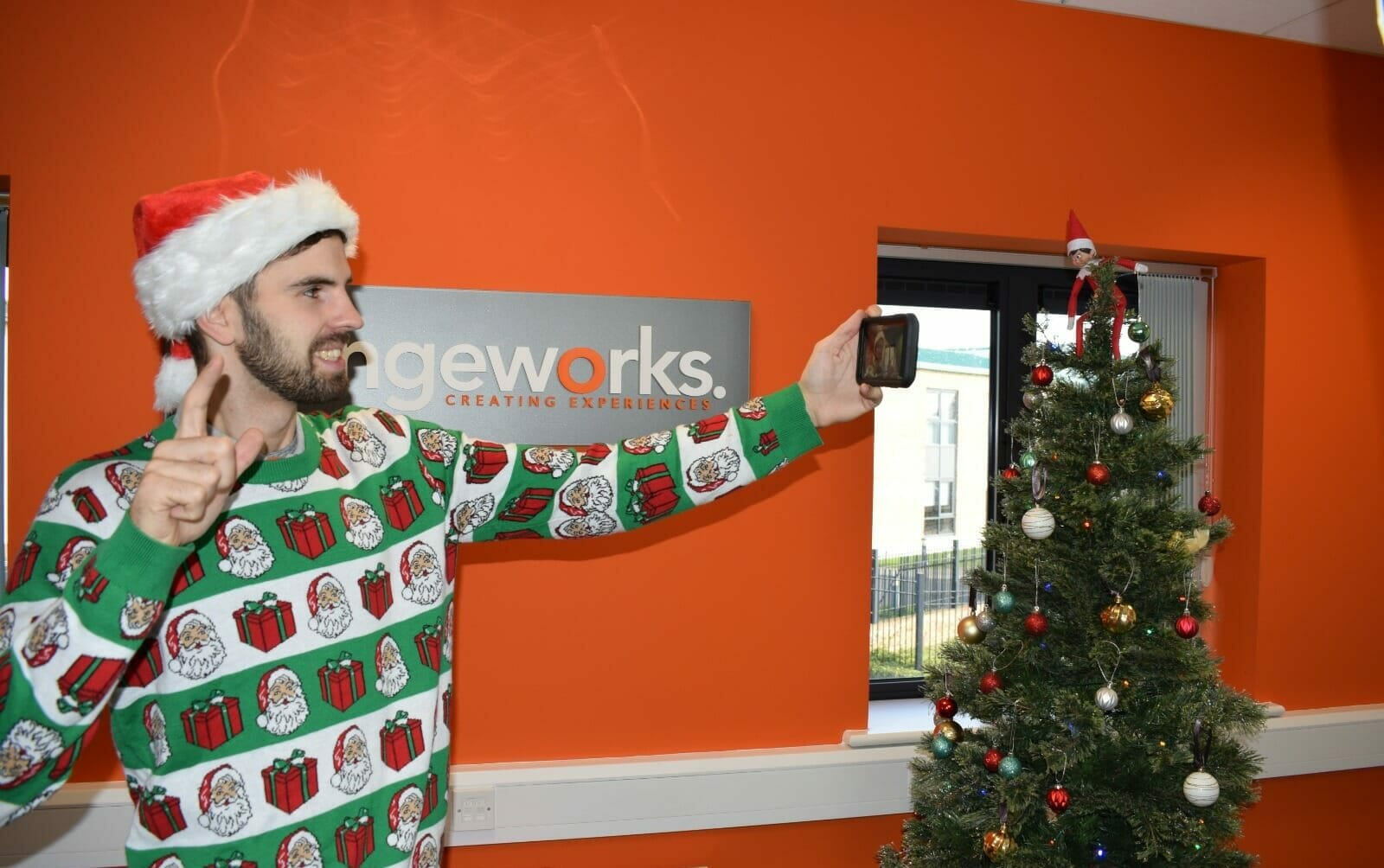 Delegate taking a selfie with his Christmas jumper on during one of Orangeworks virtual office Christmas party games.