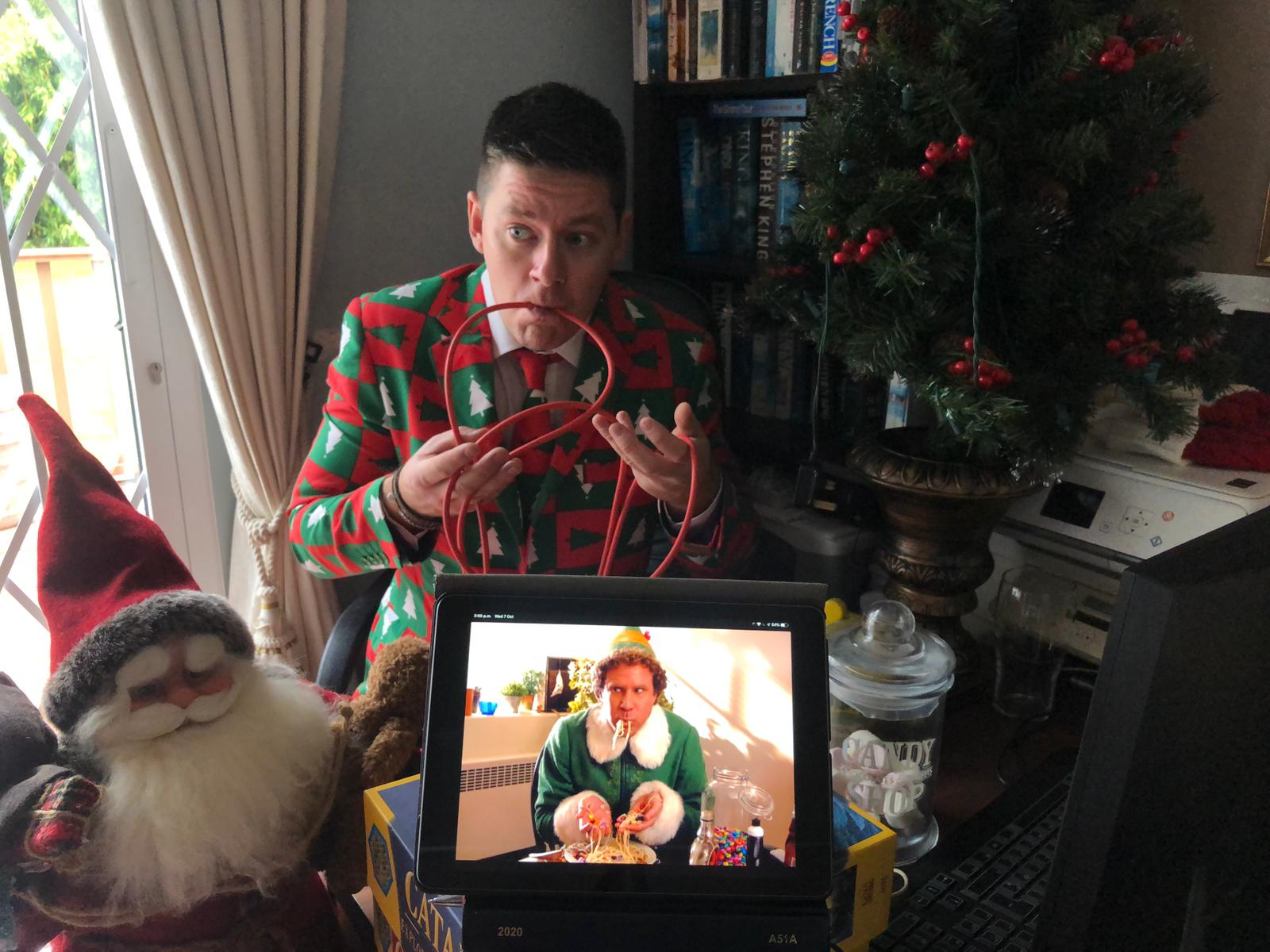 Delegate recreating a photo from Elf during one of Orangeworks team building activities called A Picture Perfect Christmas.