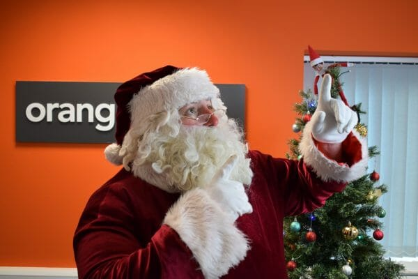 Santa pointing to the roof during a game of Who Stole Santa, one of Orangeworks company Christmas party activities.