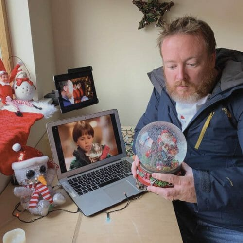 Delegate recreating a photo from Santa Clause during one of Orangeworks virtual Christmas team building activities.